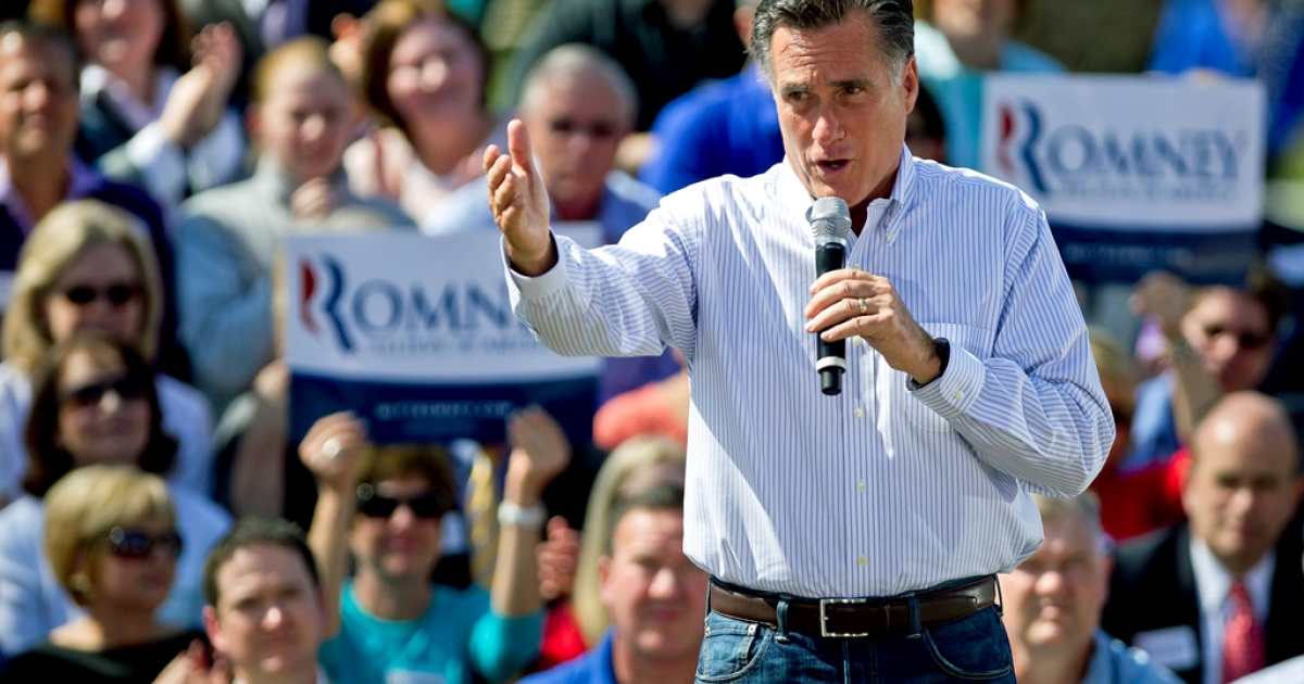 Republican presidential candidate, former Massachusetts Gov. Mitt Romney speaks to supporters during a campaign stop at Kirkwood Park March 13, 2012 in Kirkwood, Missouri. As the race for delegates continues, the latest Pew Poll has put Obama ahead of Romney.</p>