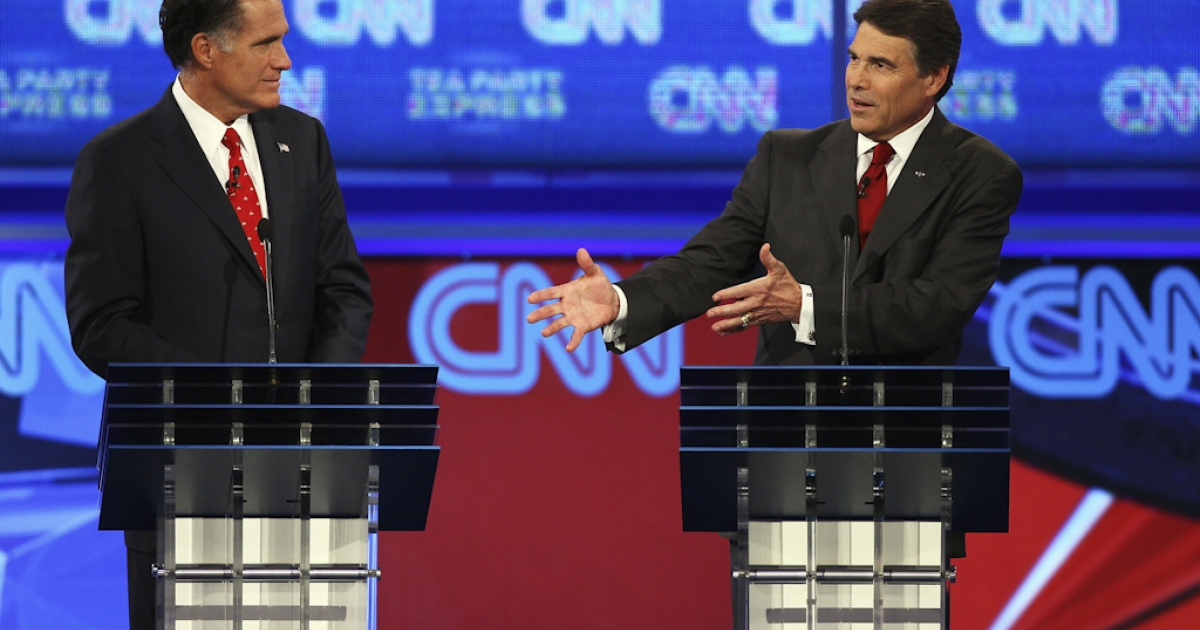 Republican presidential candidates Mitt Romney (L) and Gov. Rick Perry during the presidential debate sponsored by CNN and The Tea Party Express at the Florida State fairgrounds on September 12, 2011 in Tampa, Florida. The debate featured the eight candidates ten days before the Florida straw poll.</p>