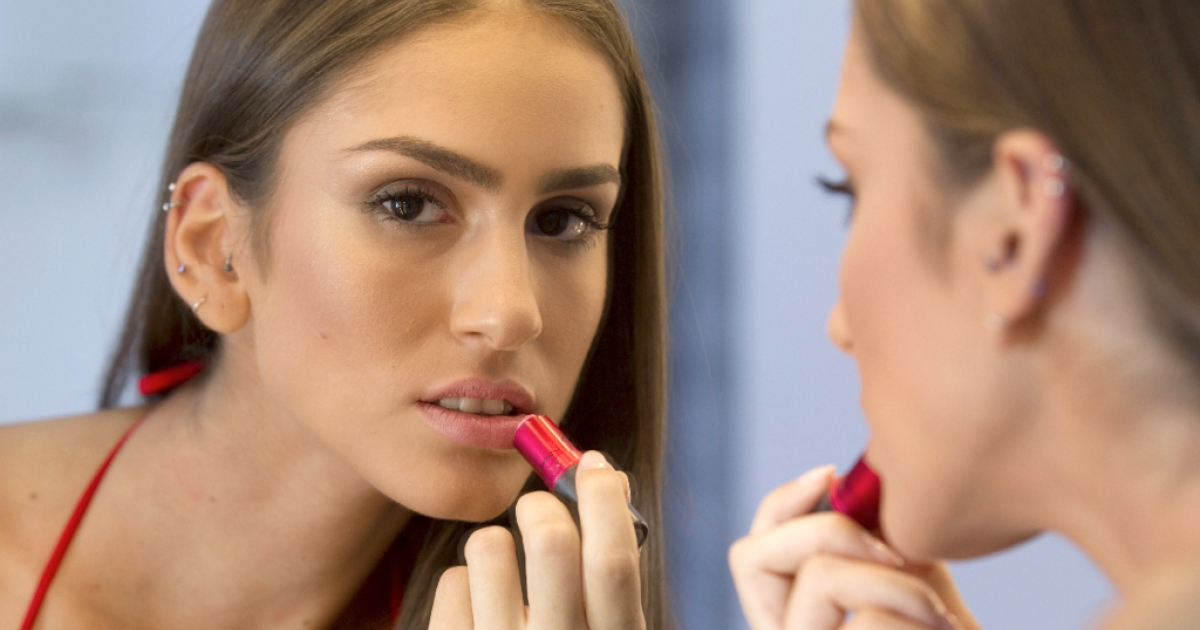 Arab-Israeli model Huda Naccache, 22, puts the final touches to her make-up before a photoshoot in Israel on September 18, 2011.</p>