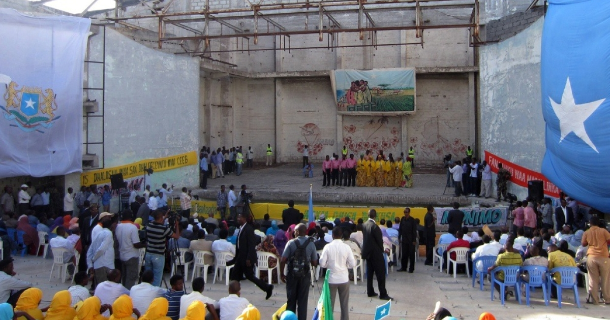 Spectators gather to watch a performance staged by artists at the open-air, Chinese-built Somalia National Theatre which was reopened for the first time in 20 years, on March 19, 2012, in Mogadishu. Just a few weeks later the theater was bombed by Al Shabaab.</p>