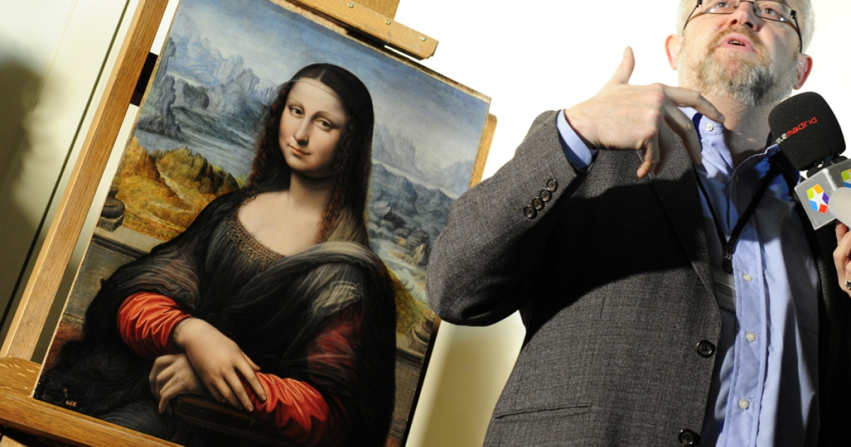 Head Curator for the Department of Italian Renaissance Painting at the Prado Museum Miguel Falomir talks to the press next to an authenticated contemporary copy of Leonardo da Vinci's Mona Lisa presented at the Prado Museum after it was found in its vaults. According to details of experts' findings, the work is a copy painted in Da Vinci's studio by one of his pupils.</p>