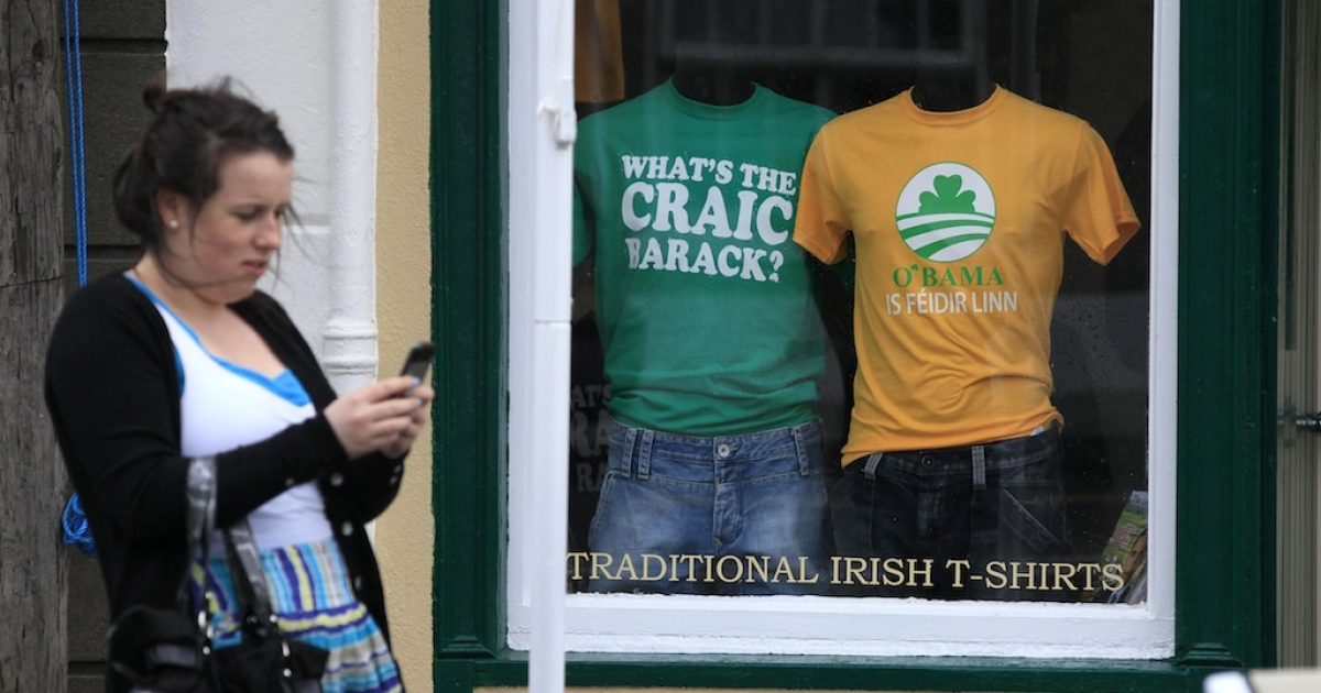 T-shirts are displayed in a shop front in Moneygall, on May 21, 2011, ahead of U.S. President Barack Obama's visit to his ancestral home.</p>