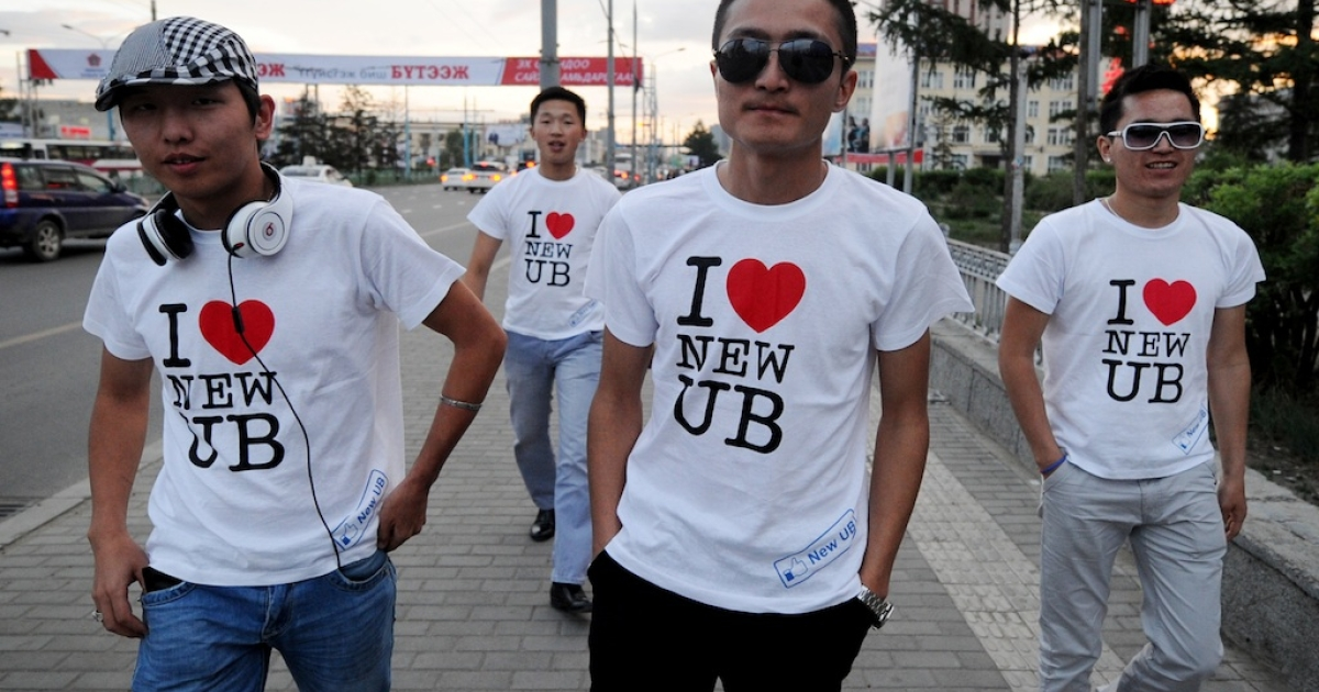 A group of young men wear 'I love the new Ulan Bator' t-shirts as they head out to a bar in Ulan Bator on June 22, 2012. Mongolia's opposition Democratic Party has established a strong lead over the ruling Mongolian People's Party ahead of the upcoming parliamentary elections.</p>
