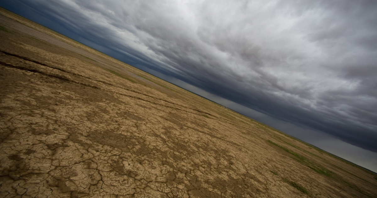 Storm clouds and a desertified landscape are seen into the horizon in Mongolia's Gobi Desert.</p>