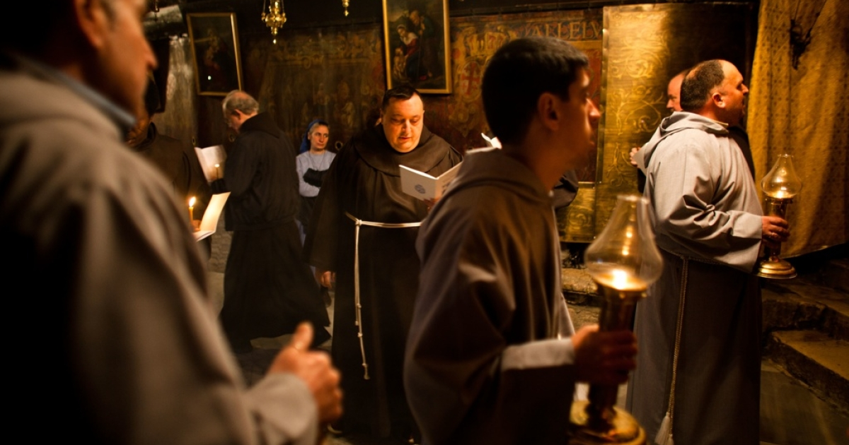 Monks behave appropriately at the Church of the Nativity on Dec. 22, 2011 in Bethlehem, West Bank.</p>