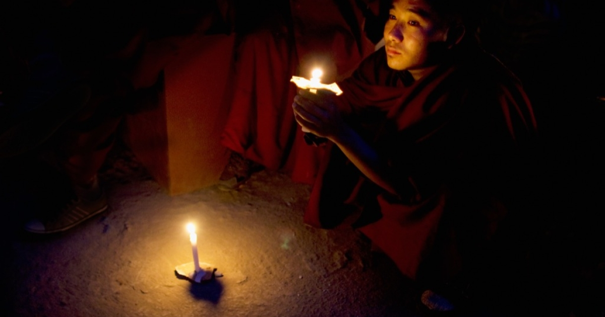 A Tibetan monk in exile looks on during a candle lit vigil to commemorate 50 years in exile on March 10, 2009 in Dharamsala, India. His Holiness the Dalai Lama marks 50 years of exile today in Mcleod Ganj, the seat of the exiled Tibetan government near the town of Dharamsala.</p>