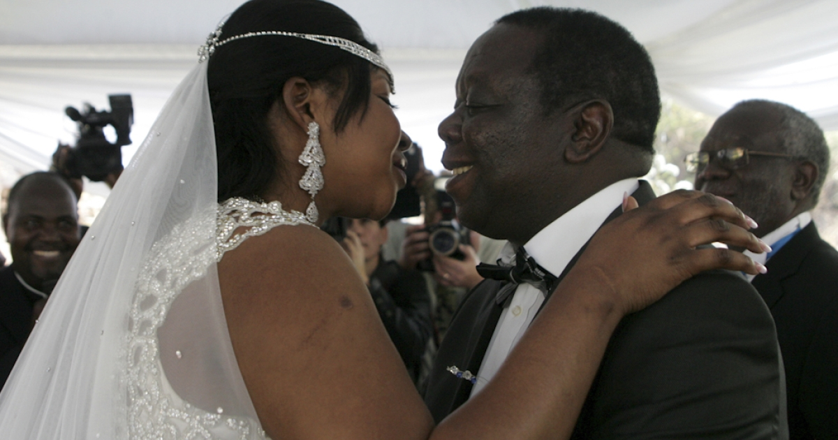 Zimbabwe Prime Minister Morgan Tsvangirai (R) kisses his wife Elizabeth Macheka (L) after exchanging vows at a customary law ceremony during their wedding held in Harare on September 15, 2012.</p>