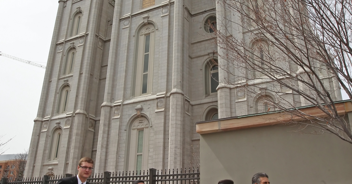 Mormon faithful walk past the historic Salt Lake Temple in Salt Lake City, Utah, on their way to the 180th Annual General Conference of the church on April 3, 2010.</p>