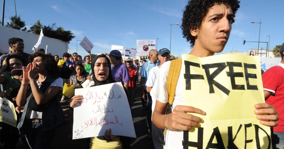 A picture taken on September 11, 2011 shows a young Moroccan holding a banner as he demonstrates in Rabat, during a protest called by the country's youth-based 'February 20' Movement to demand political and social changes and the release of Moad Al-Haqed. Rapper protester and 'February 20' Movement activist, Moad Al-Haqed, has been detained for four days, after he has been charged of the aggression of a counter demonstrator, his lawyer said.</p>