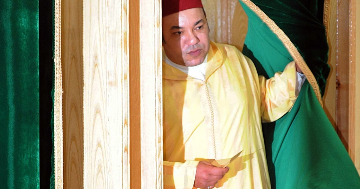 Morocco King Mohammed VI leaves a polling booth to vote in a referendum on curbing his near absolute powers on July 1, 2011 in Rabat. The King has offered reforms following protests inspired by pro-democracy uprisings around the Arab world.</p>