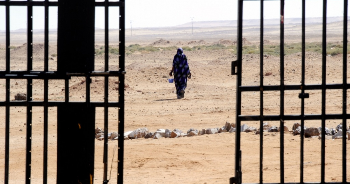 A Sahrawi woman walks in the desert near the Western Sahara refugees camp in Tindouf. Morocco's de facto governance of Western Sahara since gaining full control in 1979 remains a point of bitter contention for the Polisario and Algeria.</p>