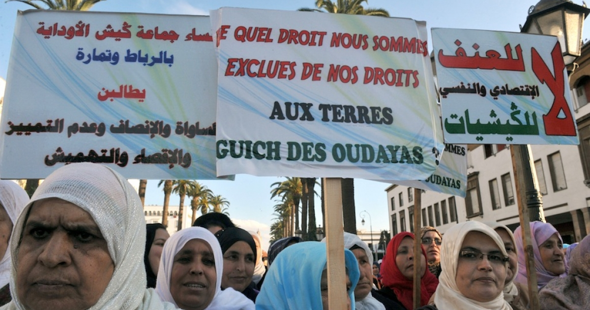 Moroccan women attend a rally during International Women's Day in Rabat in 2011. The poster reads 'We are denied the rights to our land'. Women across tribal areas are seeking changes in laws that would allow them to inherit family land.</p>