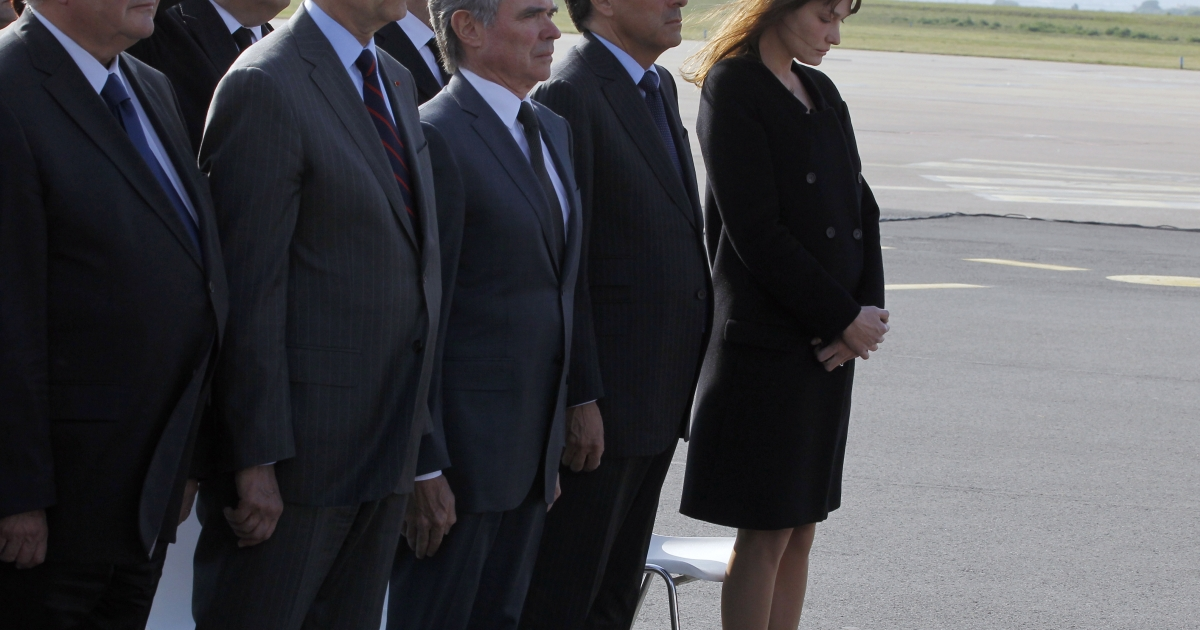 France's First Lady Carla Bruni Sarkozy (far right) joins French Justice Minister Michel Mercier, Foreign Affairs Minister Alain Juppe, the president of the National Assembly Bernard Accoyer and France's prime Minister Francois Fillon on May 3, 2011 at the Orly airport, near Paris, for the return of the bodies of eight French nationals killed in the Marrakesh cafe bombing last week.</p>