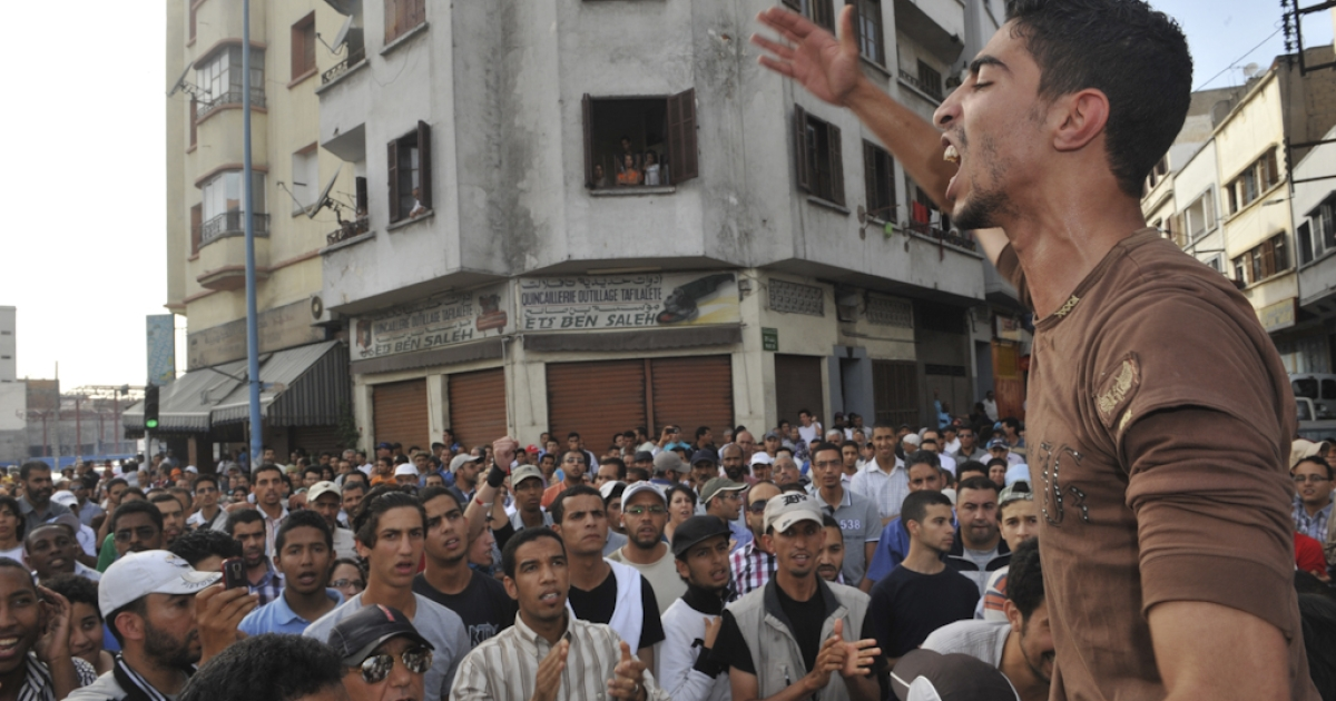 Moroccan youth take part to a protest on June 19, 2011 in Casablanca called by the country's youth-based February 20 Movement to protest against constitutional reforms proposed by King Mohammed VI. The February 20 Movement considers the reforms announced by the king in a nationwide address on June 17 do not go far enough.</p>