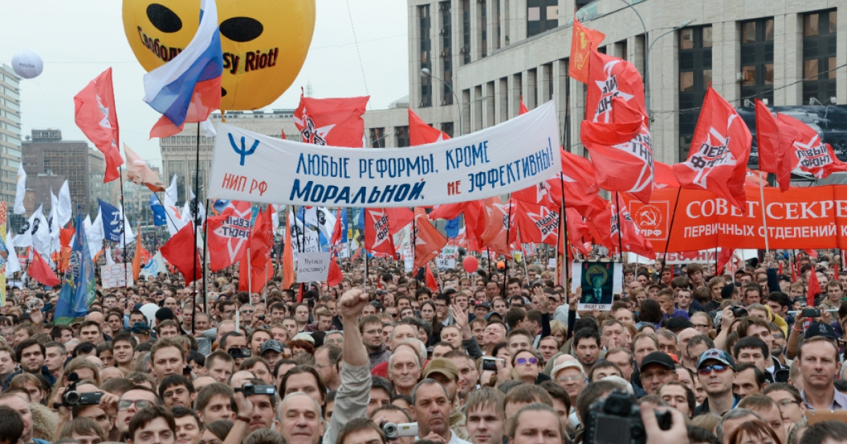 Opposition activists and supporters take part an anti-Putin protest in central in Moscow, on September 15, 2012. Thousands marched today through Moscow to protest against the rule of Vladimir Putin in a test of the opposition's challenge to the Russian president four months after his inauguration. It was also the first mass action since the sentencing of three members of Pussy Riot to two years in prison for an anti-Putin protest in an Orthodox cathedral, which has become a rallying cause for many in the opposition.</p>