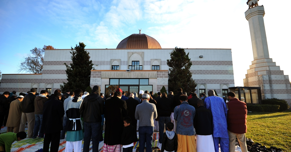 Muslim devotees take part in a special morning prayer to mark the start of the Eid-al-Adha festival on Nov. 6, 2011, at a mosque in Silver Spring, Md.</p>