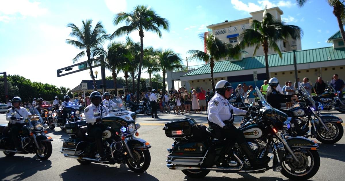 A motorcade for US Republican presidential candidate Mitt Romney cruises through Delray Beach, Fla., Oct. 20.</p>