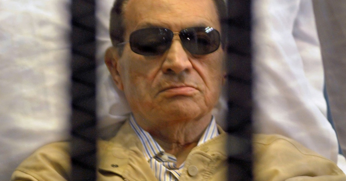 Ousted Egyptian president Hosni Mubarak sits inside a cage in a courtroom during his verdict hearing in Cairo on June 2, 2012. A judge sentenced Mubarak to life in prison after convicting him of involvement in the murder of protesters during the uprising that ousted him last year.</p>