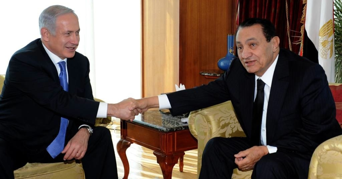 Egypt's former president, Hosni Mubarak (right), reportedly suffers from stomach cancer and his health is deteriorating quickly.  Seen here shaking hands with Israeli Prime Minister Benjamin Netanyahu in January, Mubarak has since stepped down and could soon be executed if convicted of ordering the killings of protesters in January.</p>
