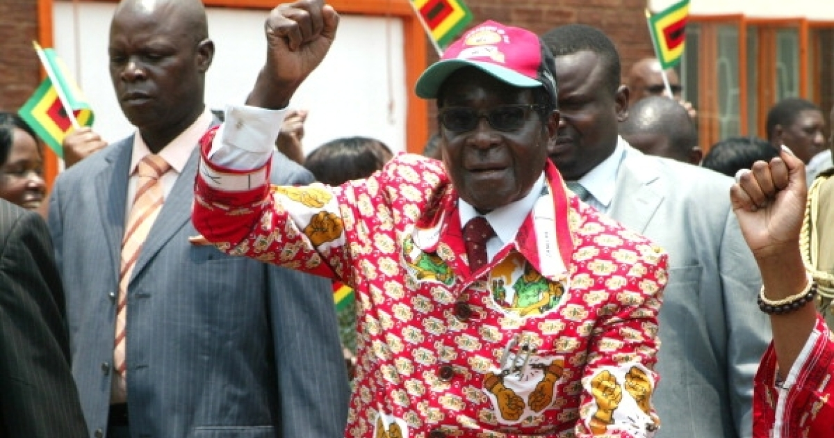 Pretty in pink. Zimbabwe President and leader of ZANU PF Robert Mugabe arrives at the party's 12th National People's Conference in Bulawayo, on December 8, 2011.</p>