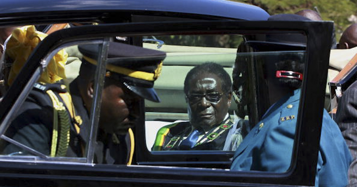 Zimbabwe's President Robert Mugabe arrives in his motorcade for the opening of the third session of the parliament in Harare on July 13, 2010.</p>