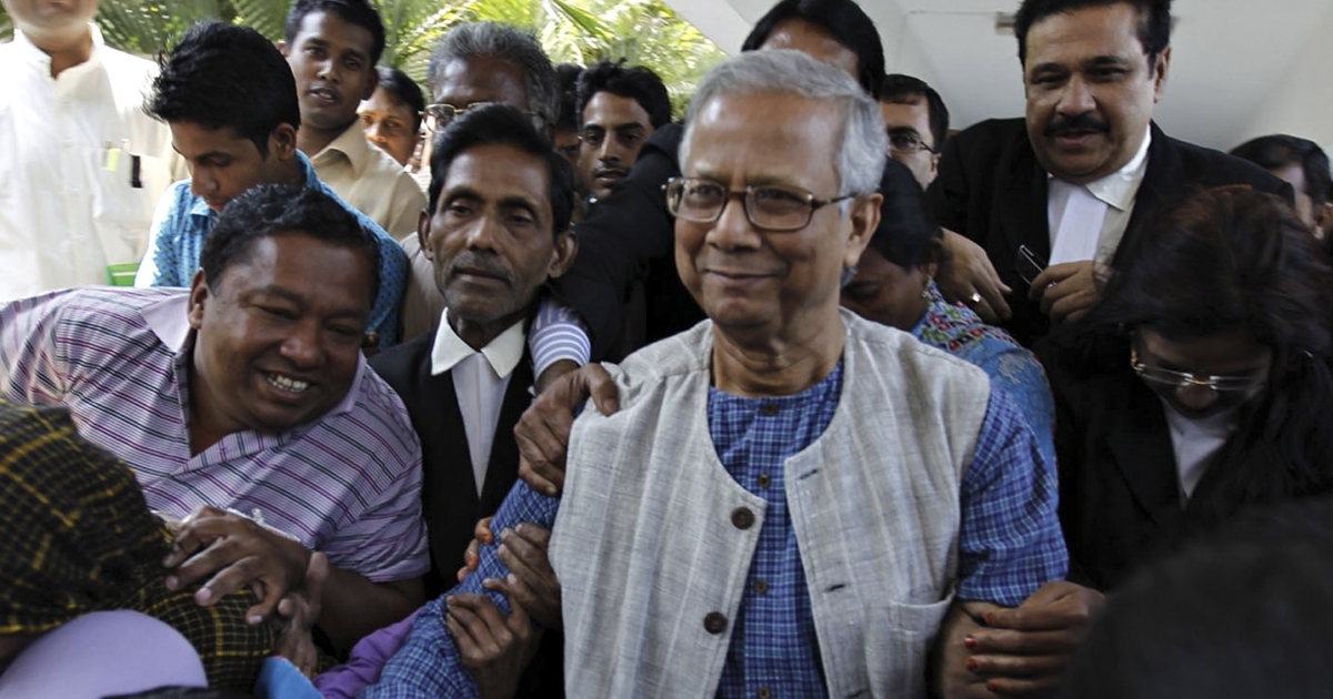 Microfinance pioneer Muhammad Yunus (C) emerges from the high court building to contest the decision to remove him from his post in Grameen Bank, in Dhaka on March 3, 2011. Bangladesh's Nobel-winning microfinance pioneer Muhammad Yunus began a legal battle March 3 to overturn an attempt by the government to sack him from the bank he founded.</p>