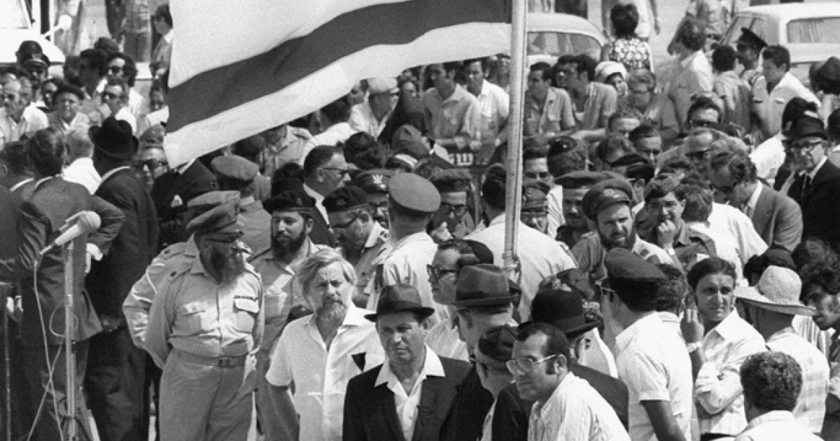 Israel's national flag flies at half-mast as the coffins of the 11 Israeli athletes murdered by Palestinian terrorists in the Munich Olympics arrive September 7, 1972 at the international airport at Lod, near Tel Aviv, Israel.</p>