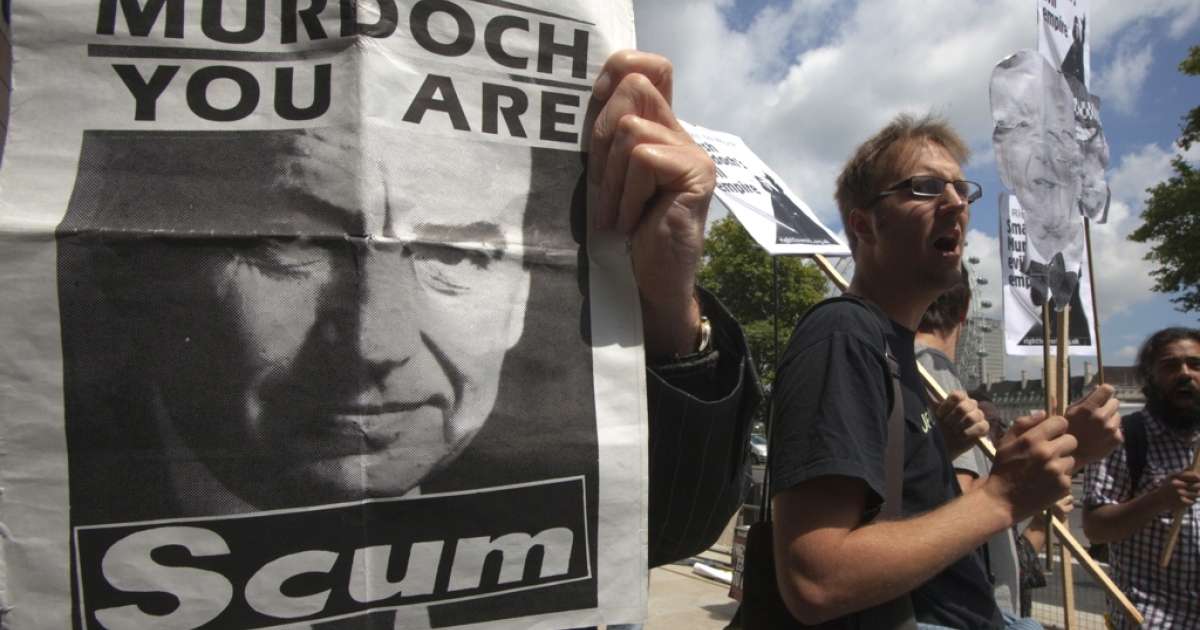 Protesters gathered outside Parliament Square, shouting anti-Murdoch slogans in London last year.</p>