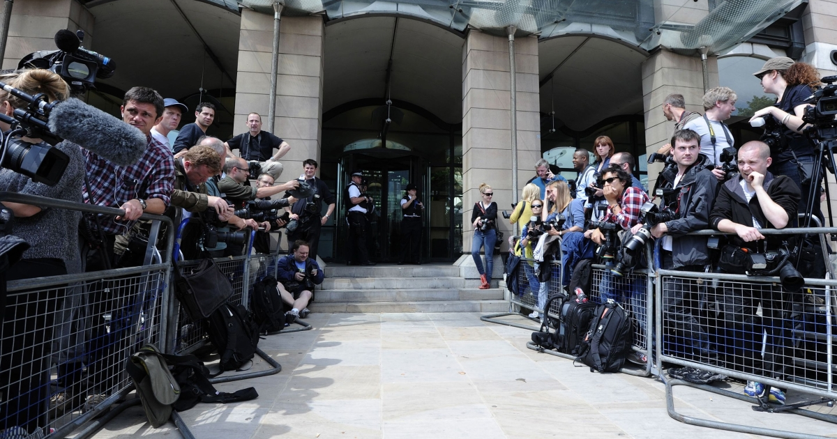 Journalists waiting outside Britain's Houses of Parliament on July 19, 2011, for the arrival of media tycoon Rupert Murdoch, son James and former top aide Rebekah Brooks on Tuesday to answer questioning by the Home Affairs Select Committee on the phone hacking scandal.</p>