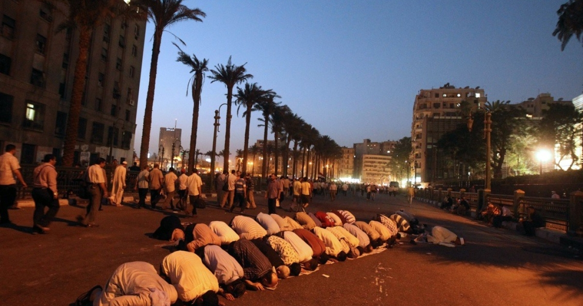 Egyptian supporters of Muslim Brotherhood presidential candidate Mohammed Morsi pray in Cairo's Tahrir Square on June 19, 2012.</p>