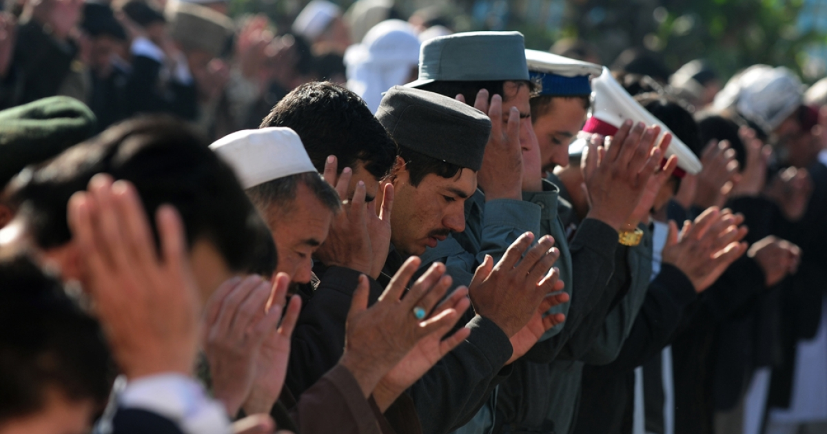 Afghan devotees pray during Eid al-Adha at the Shah-e Do Shamshira mosque in Kabul on October 26, 2012.</p>