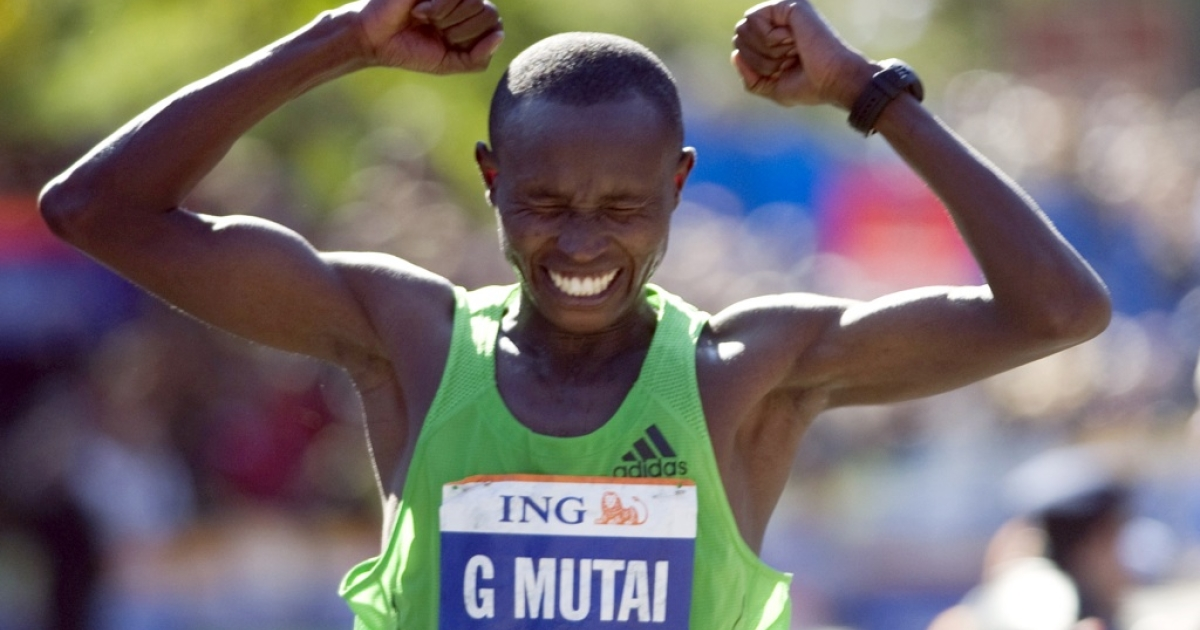 Geoffrey Mutai of Kenya reacts as he crosses the finish line to win the ING New York City Marathon on Nov. 6, 2011, in New York.</p>