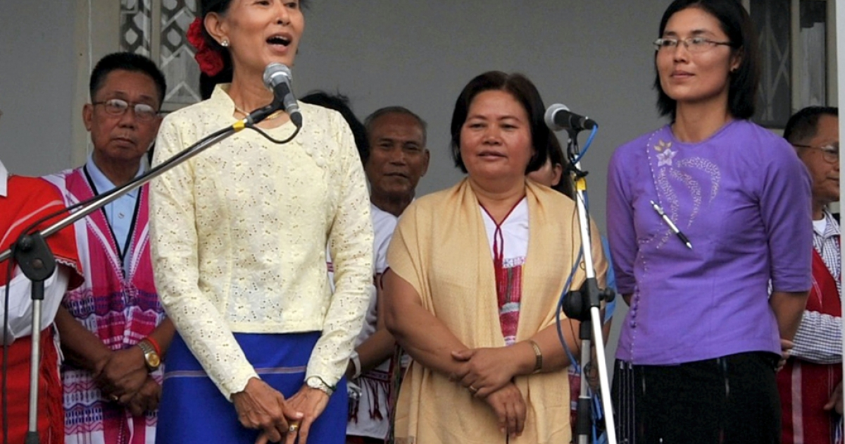 "From left to right: Aung San Suu Kyi; Zipporah Sein, general secretary of the Karen National Union; May-Oo Mutraw, senior peace negotiator with Karen National Union in purple. Please ignore Getty's unusual spelling of ""Si Pho Ra"" for what should be ""Zipporah.""</p>"
