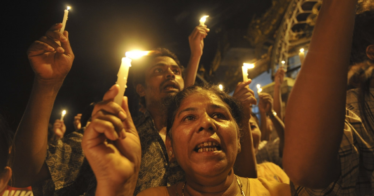 Demonstrators in Myanmar protest against severe power cuts at Sule pagoda in Yangon, May 22, 2012.</p>