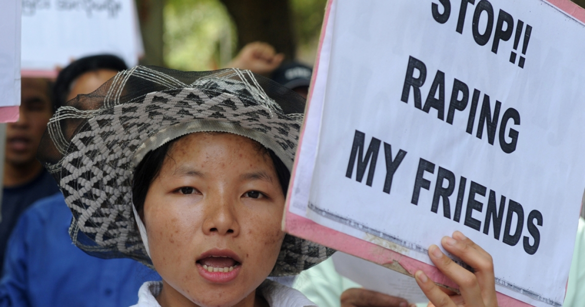 A pro-democracy activist from Myanmar holds a placard as she shouts slogans during a protest against the Myanmar army in New Delhi on June 9, 2012.  Some 100 activists demanded an immediate end to the humanitarian crisis in their homeland state of Kachin.</p>
