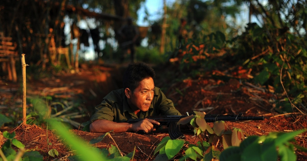 A soldier from the All Burma Students Democratic Front - Northern Burma, an ally of the Kachin Independence Army, holding his weapon in September, 2012, as he looks out from an outpost near Laiza. (AFP PHOTO/ Soe Than WIN)</p>