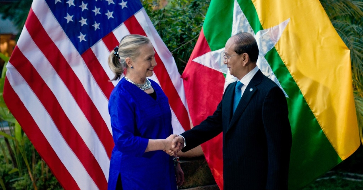 US Secretary of State Hillary Clinton shakes hands with Myanmar President Thein Sein before a meeting in Siem Reap on July 13. Clinton met with Myanmar President Thein Sein for landmark talks days after Washington eased its sanctions on the once-pariah state.</p>