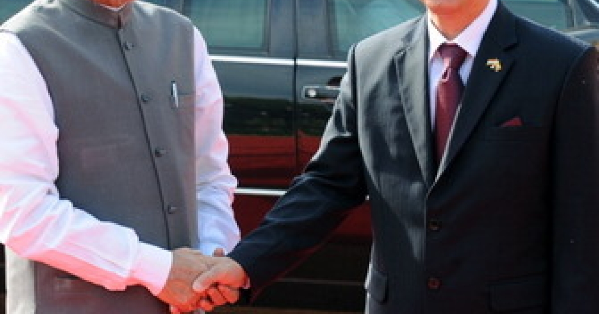 Indian Prime Minister Manmohan Singh (L) shakes hands with President of Myanmar U Thein Sein (R) during a full state welcome at the Presidential palace in New Delhi on October 14, 2011. India rolled out the red carpet for visiting Myanmar President Thein Sein, sensing a chance to deepen relations with a neighbour traditionally allied to New Delhi's regional rival Beijing. The former general, who arrived in India on October 12 and spent two days touring Buddhist pilgrimage sites, before reaching New Delhi for the official leg of his three-day visit.</p>