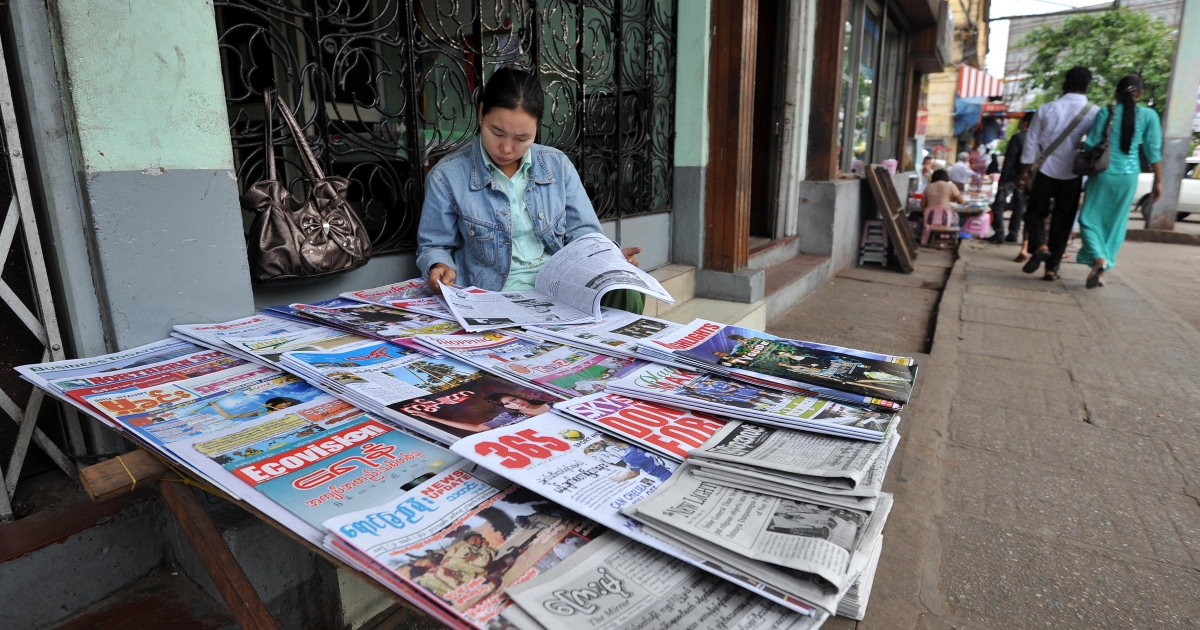 A Myanmar newspapers vendor waits for customers in downtown Yangon on March 19, 2011, which felt tremors from a6.8-magnitude earthquake Thursday.</p>