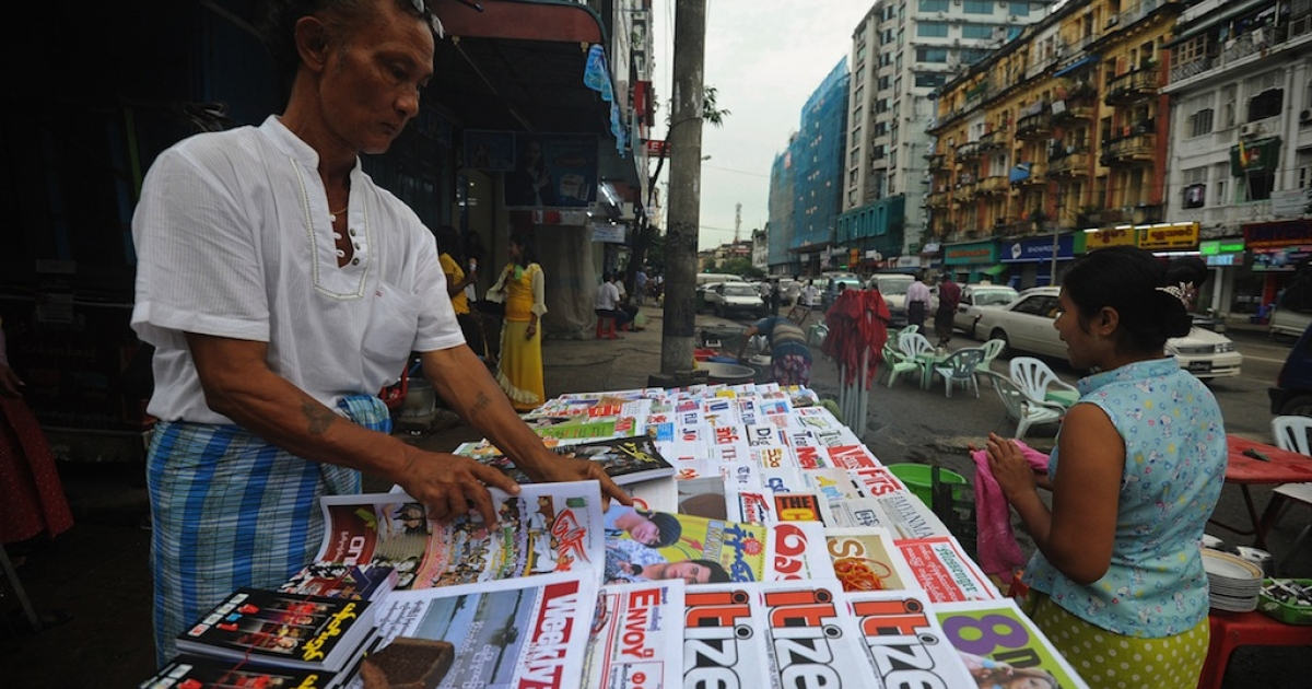 A Myanmar vendor sells local journals and newspapers on a road side in Yangon on Aug. 20, 2012. Strong economic growth could lift Myanmar to the rank of middle income nation by 2030 if the formerly army-ruled country overcomes a host of reform challenges, the Asian Development Bank said on Aug. 20.</p>
