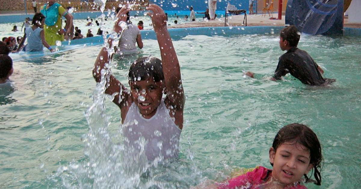 Most cases of infection are caused by swimming in contaminated water, which can allow the brain-eating amoeba to enter the nostrils. Here, children play in a swimming pool in Karachi in June 2006.</p>