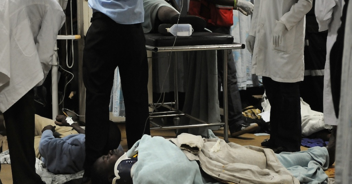 A man is assisted into the hospital on Mar. 10, 2012 after a bomb attack at a bus station in Nairobi that killed at least three people and wounded more than 20 others.</p>