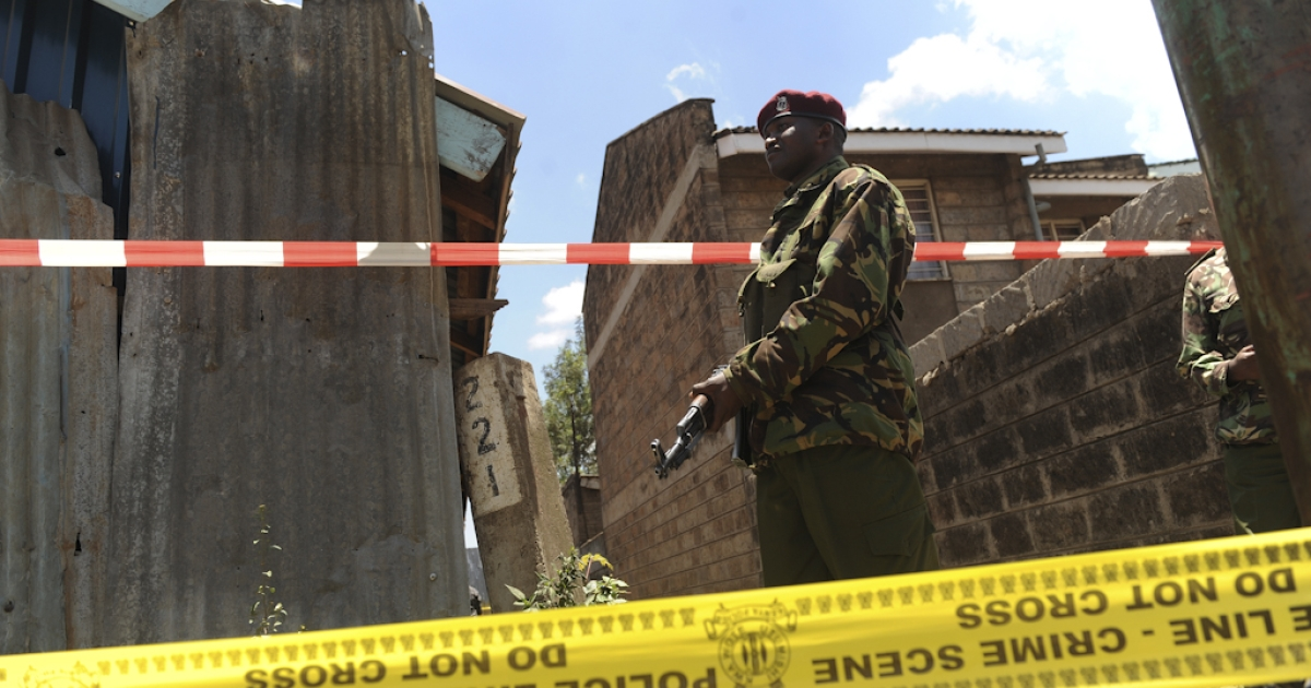 A policeman stands guard next to the scene where a blast ripped through a church in Nairobi on September 30, 2012. A suspected grenade attack killed one child and wounded nine others in a Nairobi church today, a day after Islamist fighters abandoned their last bastion in neighbouring Somalia in the face of an assault by Kenyan and other troops.</p>