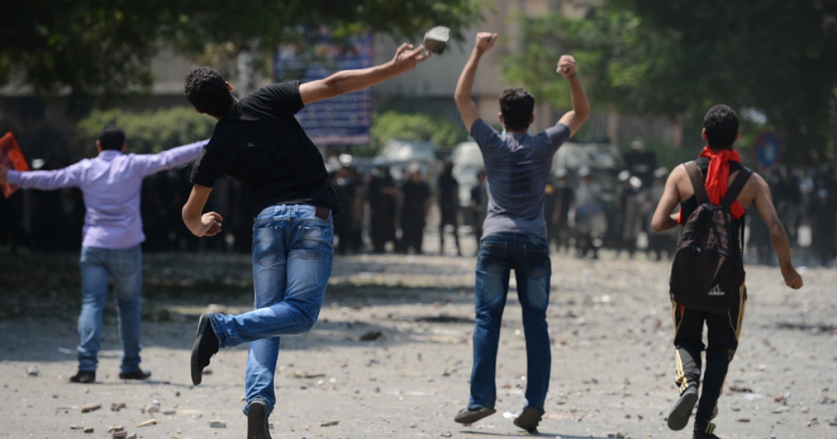 Egyptian protesters clash with riot police near the US embassy in Cairo on September 13, 2012. Police used tear gas as they clashed with a crowd protesting outside the US embassy in Cairo against a film mocking Islam.</p>