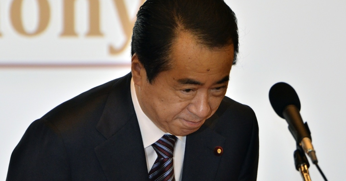 Japanese Prime Minister Naoto Kan bows as he delivers an opening speech at a UN meeting in Tokyo on June 2, 2011.</p>