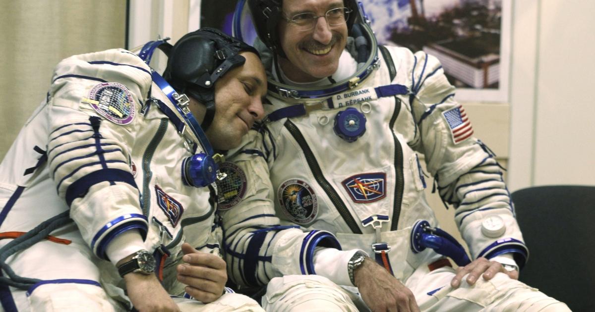 US astronaut Dan Burbank (R) shares a joke with Russian cosmonaut Anton Shkaplerov (L), while posing for a photo at Kazakhstan's Baikonur Cosmodrome before the launch of the Soyuz TMA-22 spacecraft on Nov. 14, 2011.</p>