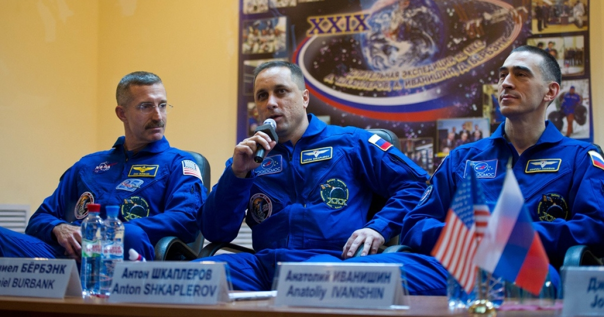Expedition 29 Soyuz Commander Anton Shkaplerov, center, answers a reporter's question during a press conference held at the Cosmonaut Hotel in Baikonur, Kazakhstan on Saturday, Nov. 12, 2011. He is seen with NASA Flight Engineer Dan Burbank, far left, and Russian Flight Engineer Anatoly Ivanishin.</p>