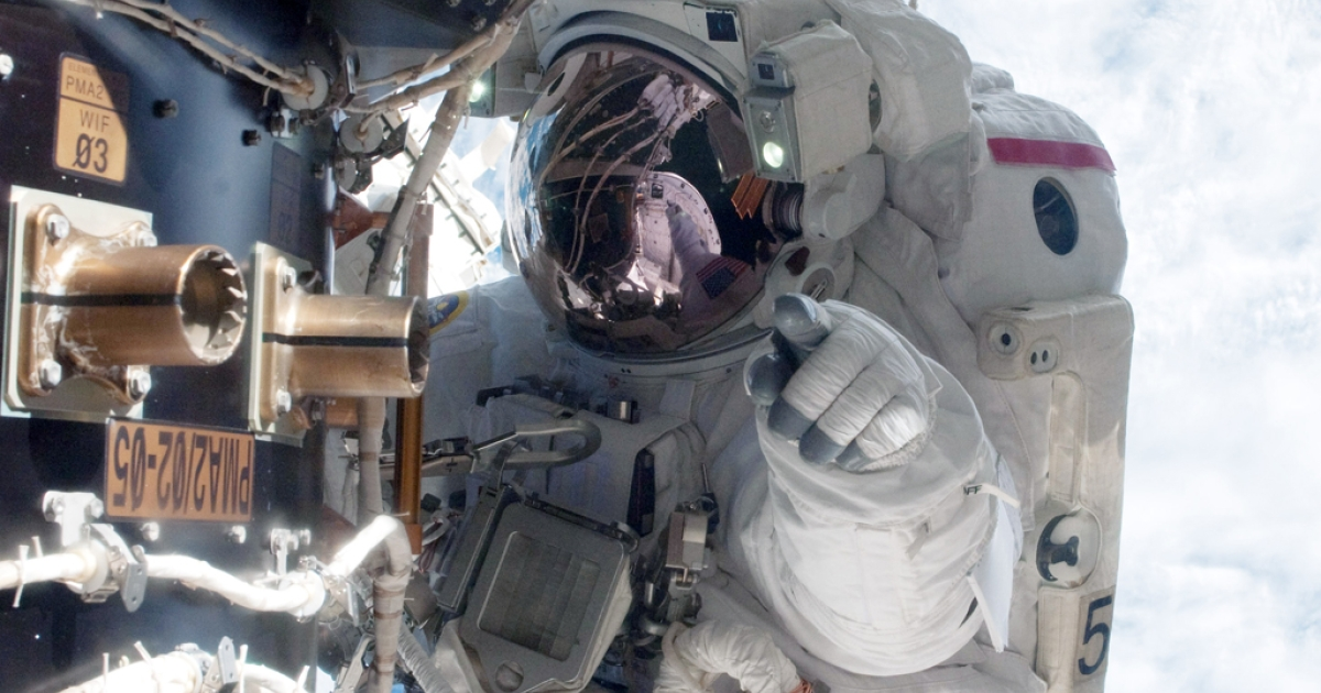 In this handout image provided by NASA, an astronaut waits at the International Space Station docked to the space shuttle Atlantis. Researchers are seeking volunteers to simulate a trip to Mars, by wearing space suits and eating food cooked with limited ingredients.</p>
