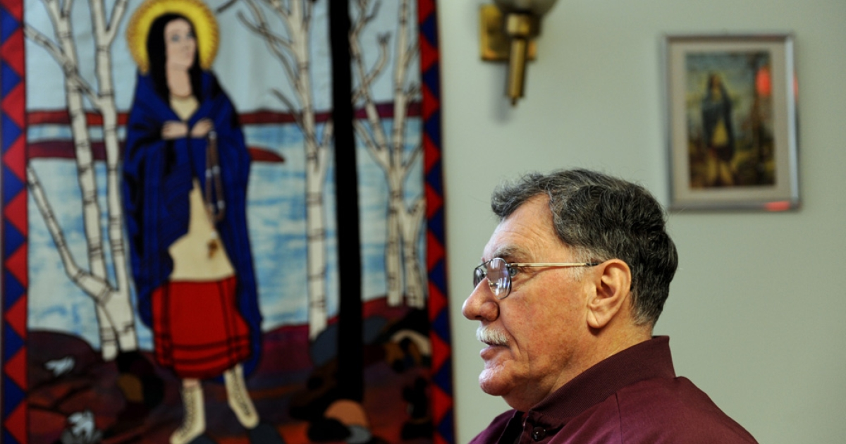 Friar Mark Steed speaks in front of a tapestry of Kateri Tekakwitha, a 17th-century Mohawk woman who the Vatican will canonize Oct. 21, at the National Kateri Shrine in Fonda, NY. Kateri will become the first Native American saint.</p>