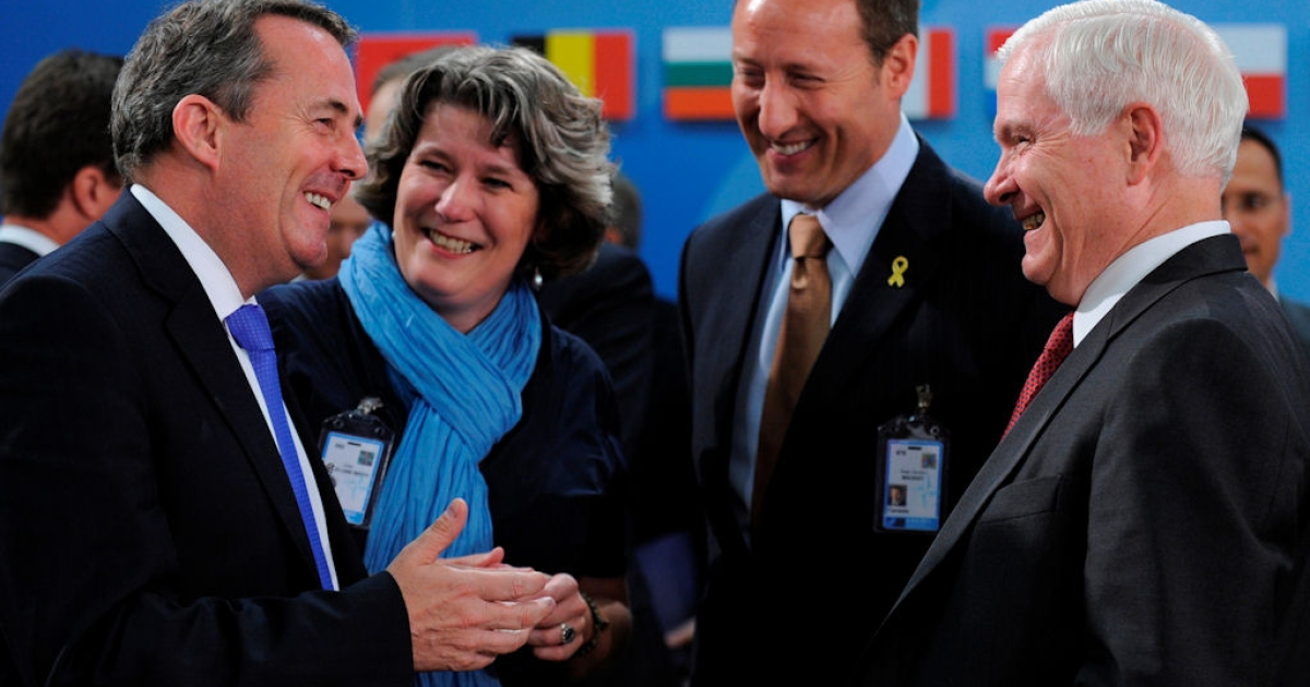 Two days before giving a speech excoriating America's NATO partners, U.S. Defense Secretary Robert Gates laughs with (from left) British Defense Secretary Liam Fox, Danish Defense Minister Bech Lillelund and Canadian Defense Minister Peter MacKay before a meeting at the alliance's Brussels headquarters. Britain, Denmark and Canada were among the